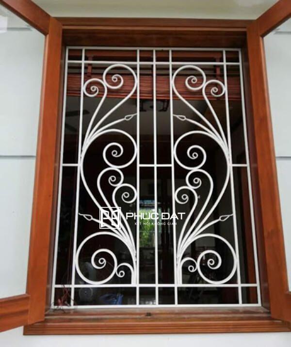 Mẫu khung cửa sổ sắt mỹ thuật đẹp bảo vệ an toàn chống trộm.
